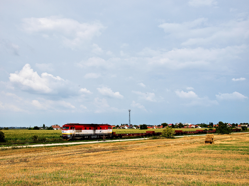 The ŽSSK Cargo 751 055-5 is seen hauling a local freight between Diósförgepatony (Orechová Potoň, Slovakia) and Szentmihályfa (Michal na Ostrove, Slovakia) photo