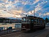 Historic tramcar number 611 of the BKV seen at Budapest Széchenyi tér by sunset with a beautiful Tyndall-phenomenon and the castle of Buda
