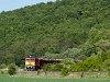 The MÁV-TR M62 228 is hauling a loaded lumber train between Püspökhatvan and Acsa-Erdőkürt