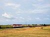 A ŽSSK Cargo 751 055-5 Diósförgepatony (Orechová Potoň, Szlovákia) és Szentmihályfa (Michal na Ostrove, Szlovákia) között egy tolatós tehervonattal
