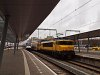 The NS 1733 electric locomotive is seen pushing an old double-decker push-pull train at Utrecht Centraal