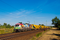 The GYSEV 1047 505 is seen hauling the Gartner container train by Szemeretelep