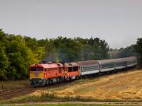 The M�V-START 628 265 is seen as a helper on a fast train to Balaton between F�le and Balatonfőkaj�r stops