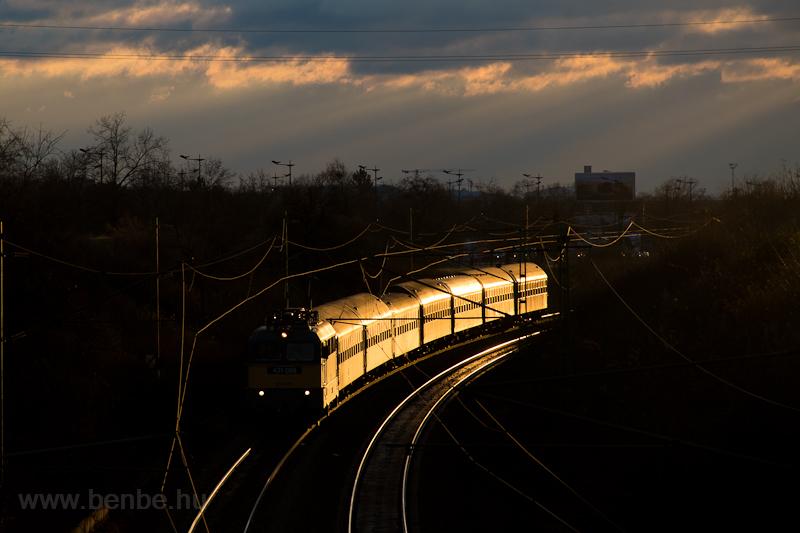 A semi-fast train coming fr picture