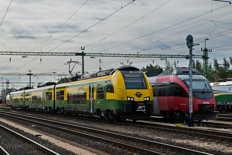A GYSEV 4744 304-8 pályaszámú Ventus/CityJet/Desiro ML motorvonata és az ÖBB 4124 023-5 pályaszámú Talentje Sopronban  fotó
