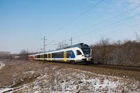 A MÁV-START 415 114 pályaszámú, kék Stadler FLIRT motorvonata csatolva két piros FLIRT-tel Herceghalom és Biatorbágy között