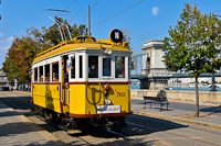 The BKV wood frame historic tram number 2806 is seen in its last operating condition and livery at Clark Ádám tér with the Lánchíd (Chain Bridge) in the background