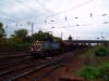 The V46 018 is pulling a train of wheat carriers to Ferencv�ros marshalling station