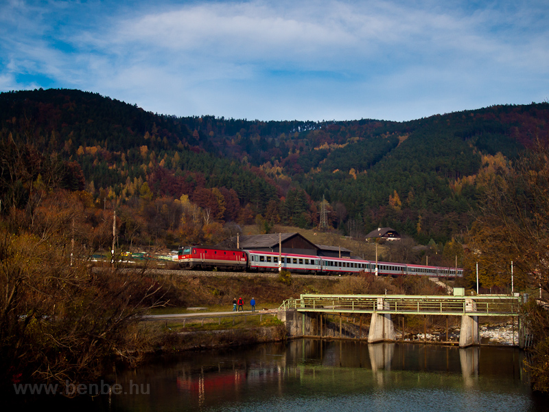 An ÖBB 1144 seen near a dam picture