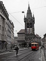 A Tatra T3 tram near the tower of Jindřišska Ves