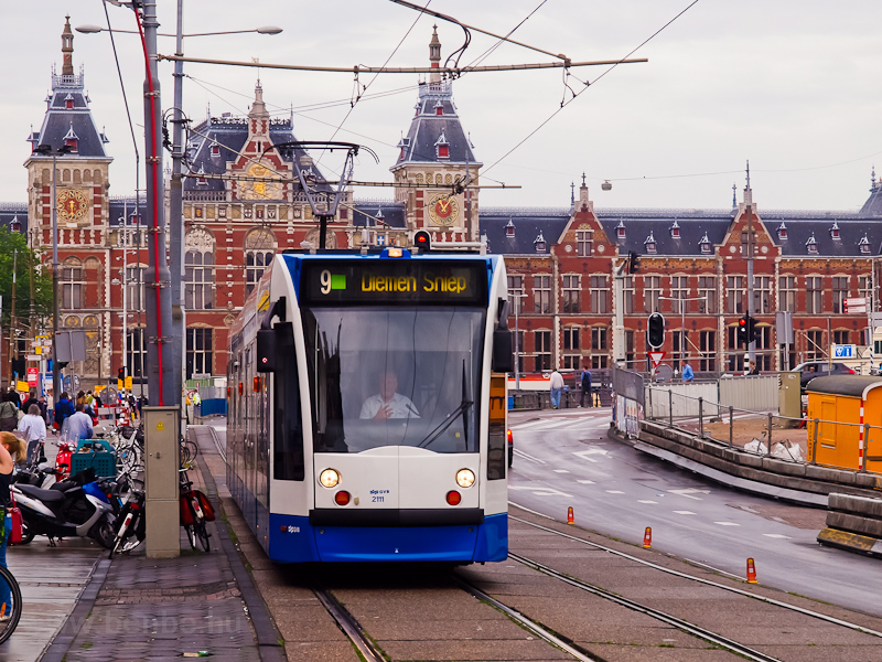 Trams near Amsterdam Centraal Station photo