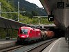 The ÖBB 1016 004-2 seen hauling a freight train at St. Anton am Arlberg
