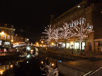 The old town of Leiden with Christmas lights along the Nieuwe Rijn