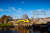 Rotating (swing) bridge on the Rijn-Schiekanaal in Leiden with a VIRM trainset