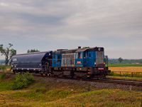 The LTE 740 413-0 seen at Jesenské zastávka hauling a single grain hopper as a freight train