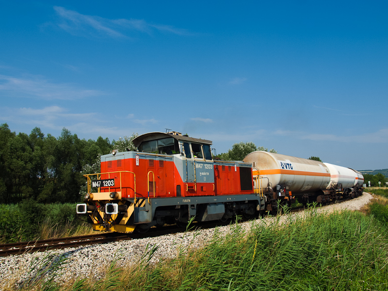 The M47 1203 is seen hauling the local freight between Dunaalmás and Almásfüzitő photo