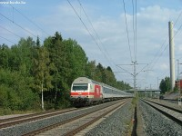 An Sr2-headed international train between Hiekkaharju and Koivukylä