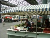 They are selling fruites nder the station roof