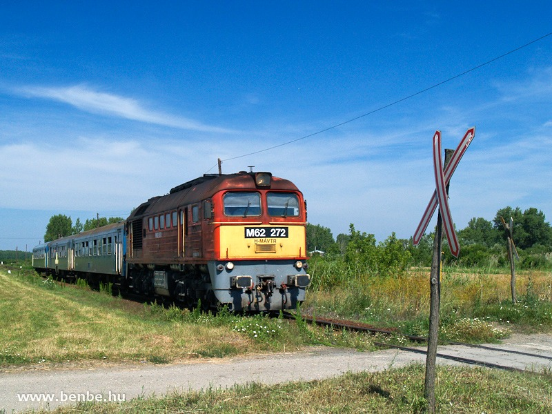 The M62 272 between Füzesabony and Mezőtárkány at a road-rail level crossing of a typical branch line style photo