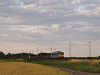 The V63 033 is pulling an empty freight train between Szihalom and F�zesabony