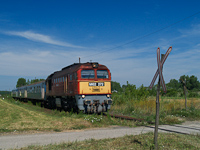 The M62 272 between F�zesabony and Mezőt�rk�ny at a road-rail level crossing of a typical branch line style