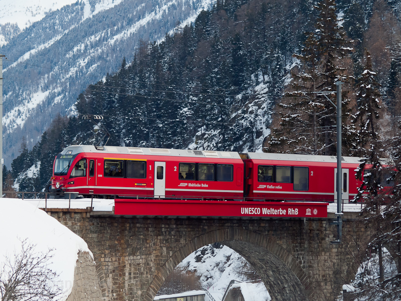 The Rhätische Bahn ABe 8/12 3508 seen between Punt Muragl Staz and St. Moritz photo