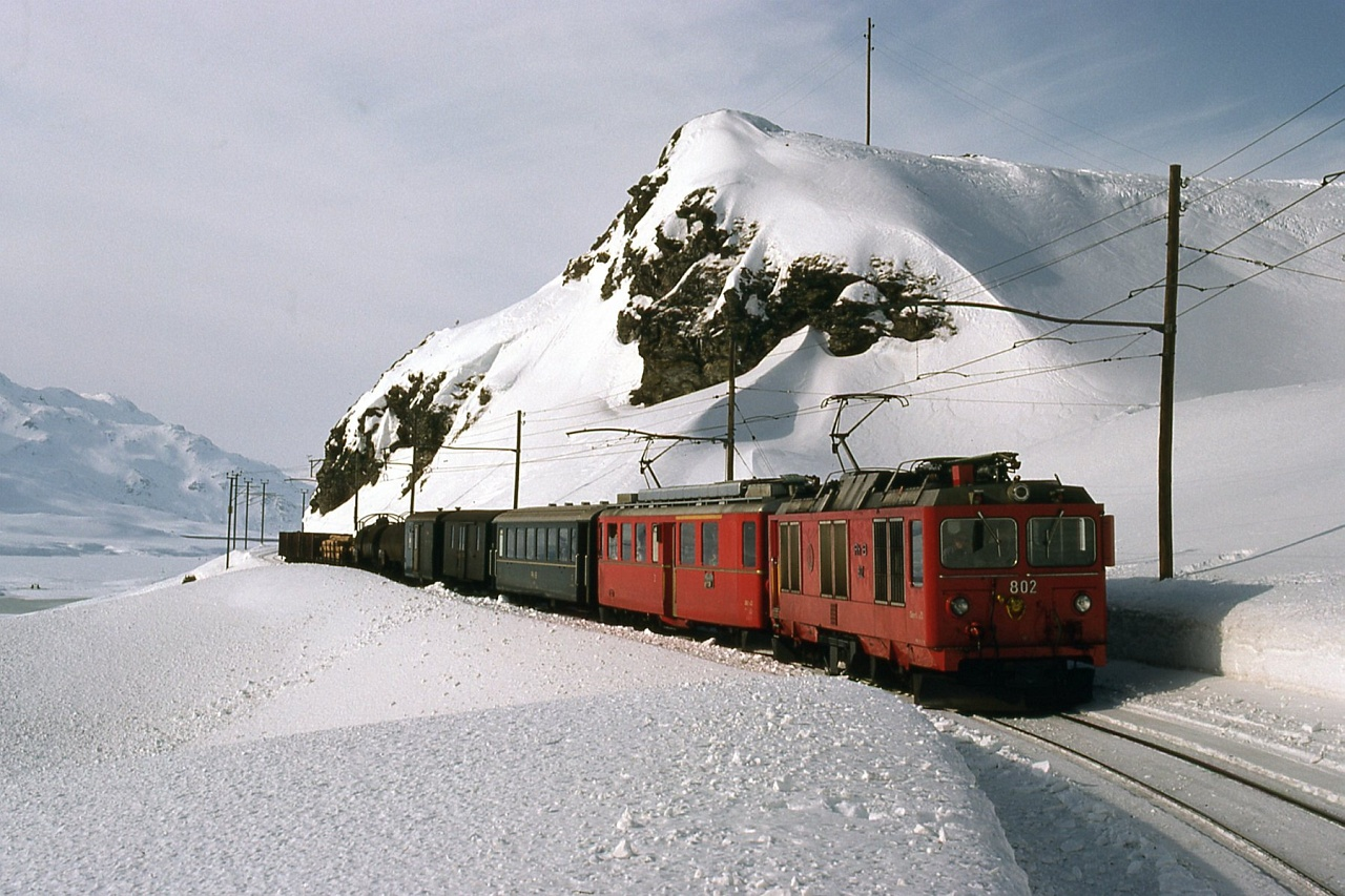 The RhB Gem 4/4 802 electro-diesel locomotive with an unidientified ABe 4/4 II between Ospizio Bernina and Alp Grüm photo