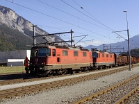 The SBB Re 420 11241 and its sister are hauling a normal-gauge freight train on the track plaite section of the RhB between Domat/Ems and Ems Werk
