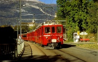 The RhB/ChA ABDe 4/4 482 and 488 DC electric railcars at the beginning of the Arosa-line by the Plessur river at Chur, 30/10/1997.
