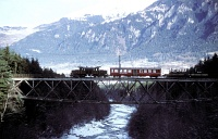 The RhB Ge 6/6<sup>I</sup> 415 hauls a freight train on the old Hinterrheinbrücke by Thusis on 08/01/1986