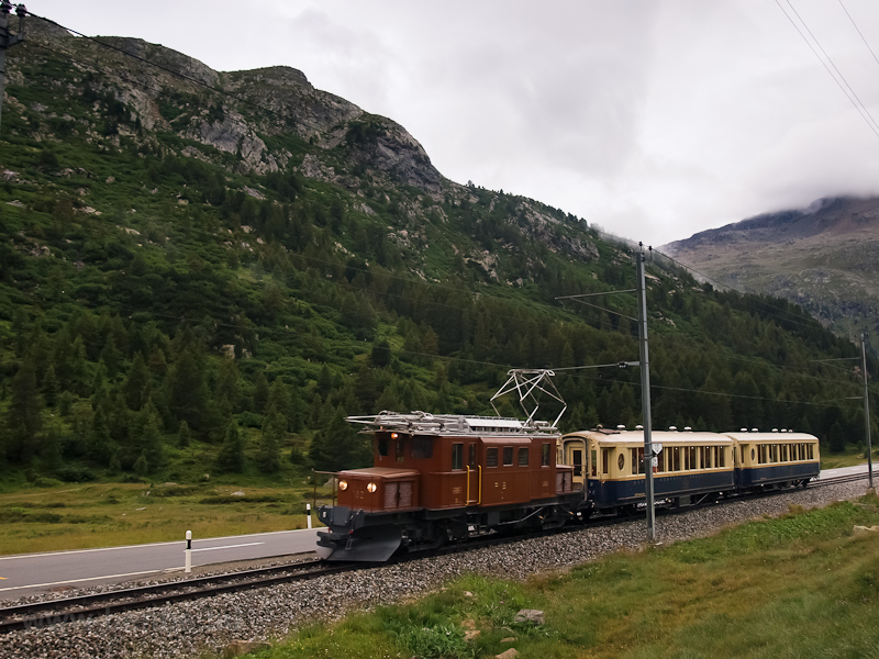 The historic Bernina Crocodile Ge 4/4 182 electric locomotive with two Alpine-Classic Pullman coaches between Morteratsch stop and Bernina Suot station on the way up the Berninapass photo