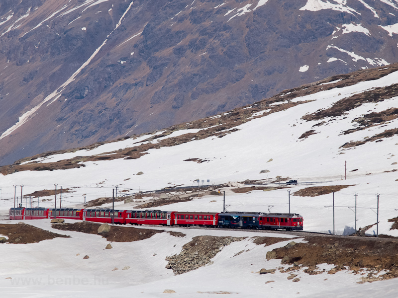 The ABe 4/4 III  54 and 52 is seen hauling the Bernina-Express panoramic train near Ospizio Bernina photo