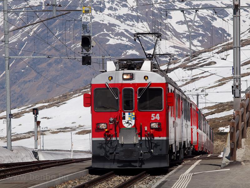 The ABe 4/4 III  54 and 52 is seen hauling the Bernina-Express panoramic train at Ospizio Bernina photo