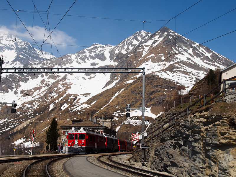 The ABe 4/4 III  54 and 52 is seen hauling the Bernina-Express panoramic train at Alp Grüm photo