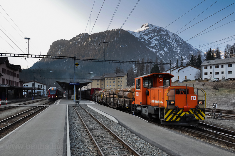 The ABe 8/12 Allegra and the Tm 2/2 113 seen at Pontresina/Puntraschigna station photo