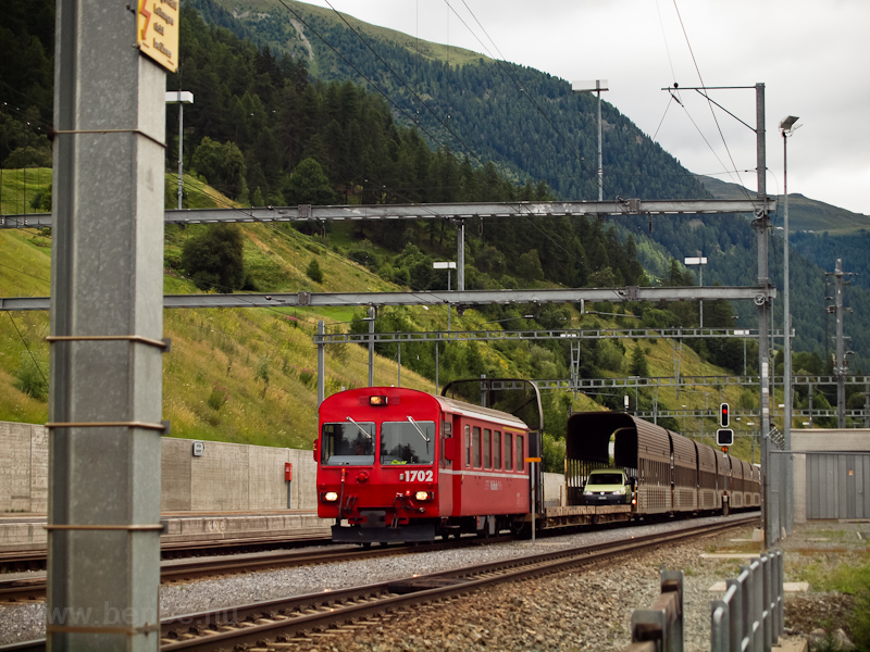 The RhB ABt 1702 cab car seen with a car shuttle train near the Vereina-tunnel at Sagliains photo