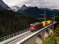 The Ge 6/6<sup>II</sup> 704 seen hauling a freight train between Ftan-Baraigla and Scuol-Tarasp on the 91 metres long Val Lumes-Viadukt