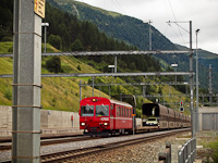 The RhB ABt 1702 cab car seen with a car shuttle train near the Vereina-tunnel at Sagliains