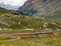Two TW III railcars, the ABe 4/4<sup>III</sup> 54 and 55 are seen hauling the Bernina Express on the Obere Berninabachbrücke between Bernina Lagalb and Ospizi Bernina