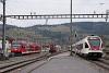 A SBB-CFF-FFS RABe 523 071 és a CJ ABe 2/6 634 Glovelier állomáson, a Chemin de Fer de Jura kiindulópontján