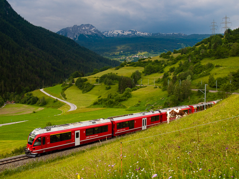 The Rhätische Bahn ABe 8/12 3508  Allegra  seen hauling a Bernina-Express between Tiefencastel and Surava photo