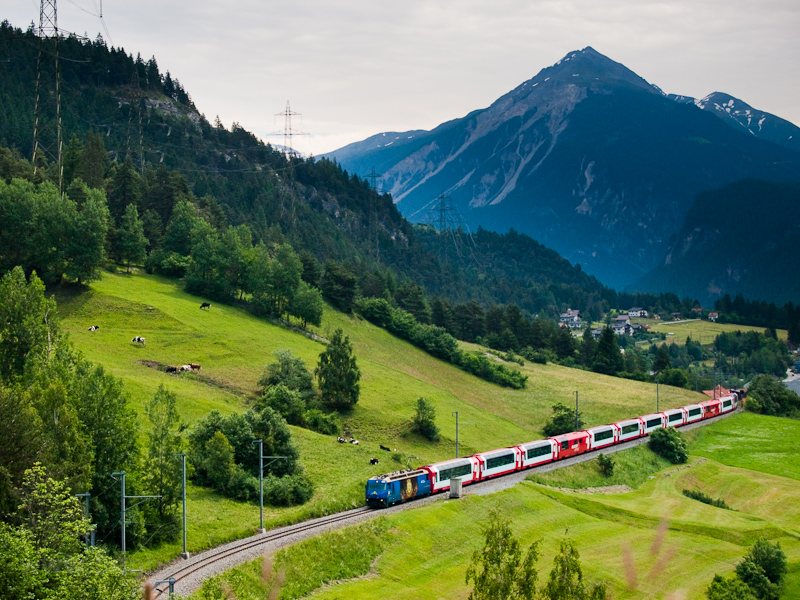 The Rhätische Bahn Ge 4/4 III  652  Hockey Club Davos  seen hauling the Glacier-Express panoramic train between Surava and Tiefencastel photo