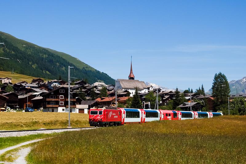 The Matterhorn-Gotthardbahn HGe 4/4 II  102 seen hauling the Glacier-Express between Münster VS and Reckingen photo