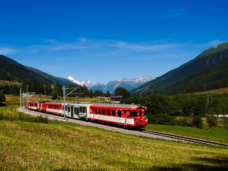 An unidentified Matterhorn-Gotthardbahn Deh 4/4 II   seen between Biel (Goms) and Blitzingen photo