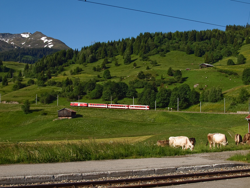 The Matterhorn-Gotthardbahn Deh 4/4 I  21 seen between Mompé Tujetsch and Segnas photo