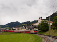 The Ge 4/4<sup>II</sup> 622 is leaving Disentis with a normal REX train