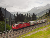 The MGB HGe 4/4<sup>II</sup> 104 is pulling a freight train out of the Las Rueras site of the Gotthard Base Tunnel construction to the main line of the Oberalppasstrecke
