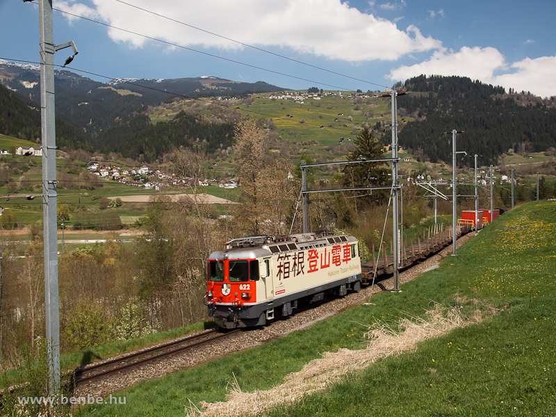 The orange-coloured Ge 4/4 II  622 wearing the advertising livery of the RhB's Japanese partner  Hakone Tozan Railway  between Castrisch and Ilanz photo