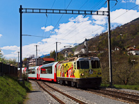 The yellow <q>log in</q> advertising livery is one of the less appealing ones. The RhB Ge 4/4<sup>II</sup> 611 is pulling the Glacier-Express Brig to Chur service at Tavanasa-Breil/Brigels.