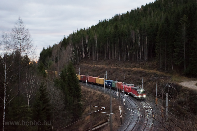 A freight train seen betwee photo